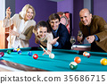 Group of friends playing billiards 35686715