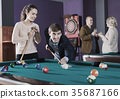 Relaxed people playing billiard and darts 35687166