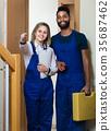 Professional workers at doorway. 35687462