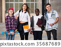Ordinary four friends with folders and backpacks 35687689