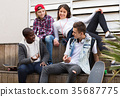 Group of teenage friends relaxing and chatting 35687775