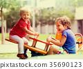 Children having fun at playground 35690123