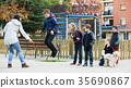 Children playing skipping rope 35690867