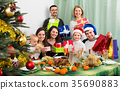 Big family gathering together for Christmas . 35690883