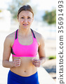 Woman practicing jogging for warm-up body 35691493