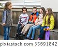 children chatting outdoors 35691842