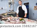 man, fish, market 35692167