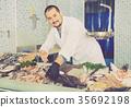 man, fish, glove 35692198