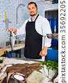 showing, counter, fish 35692205