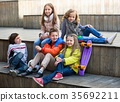 Group of children portrait with ball and skateboard 35692211
