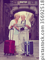 couple, suitcases, sights 35692518