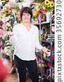 Woman client deciding on various plants 35692730