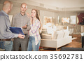 Seller offering family couple to choose furniture 35692781