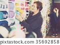 Woman choosing yarn for knitting 35692858