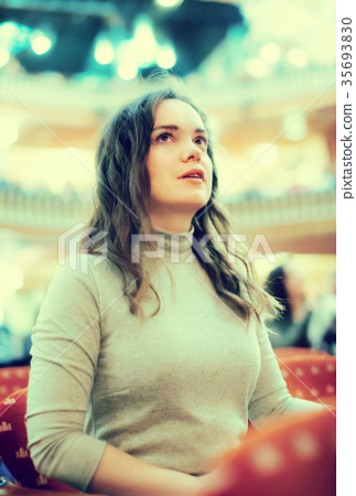 Positive woman theatre goer looking at play 35693830