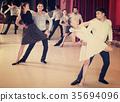 Dancing couples enjoying latin dances 35694096
