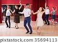 People practicing passionate samba 35694113