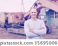 tractor operator at workplace 35695006