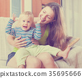 Portrait of happy woman with toddler 35695666