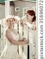 happy women near fence wicket 35696072