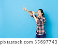 happy beautiful woman using stretch telescope tool 35697743