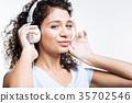 headphones, listen, woman 35702546