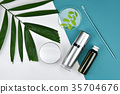 Cosmetic bottle containers with green herbal leave 35704676