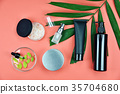 Cosmetic bottle containers with green herbal leave 35704680