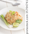 close-up fried rice on white table angle side view 35704741