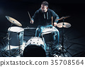 Drummer rehearsing on drums before rock concert 35708564