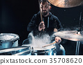 Drummer rehearsing on drums before rock concert 35708620