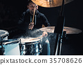 Drummer rehearsing on drums before rock concert 35708626