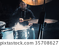 Drummer rehearsing on drums before rock concert 35708627
