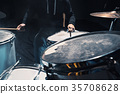 Drummer rehearsing on drums before rock concert 35708628