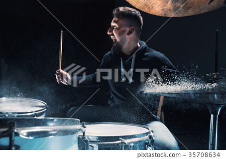 Drummer rehearsing on drums before rock concert 35708634