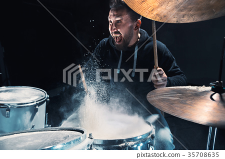 Drummer rehearsing on drums before rock concert 35708635
