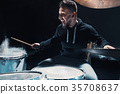Drummer rehearsing on drums before rock concert 35708637