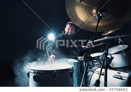 Drummer rehearsing on drums before rock concert 35708662