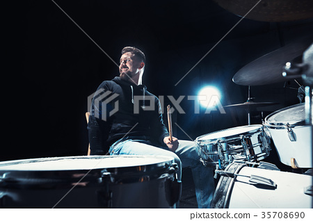 Drummer rehearsing on drums before rock concert 35708690