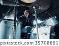 Drummer rehearsing on drums before rock concert 35708691