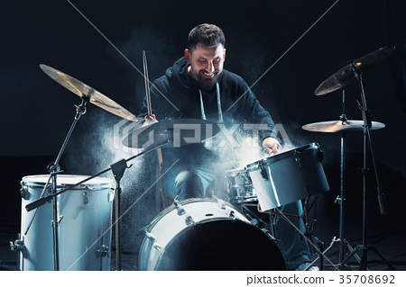 Drummer rehearsing on drums before rock concert 35708692
