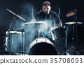 Drummer rehearsing on drums before rock concert 35708693