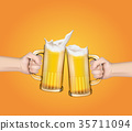 Hands holding glass mugs with beer raised in a 35711094