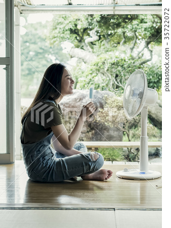 Woman relaxing at home 35722072