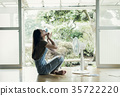 Woman relaxing at home 35722220