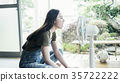 Woman relaxing at home 35722222
