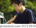 Boy baseball break water boy washing face 35723919