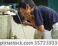Boy baseball break water boy washing face 35723933