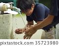 Boy baseball break water boy washing face 35723980