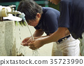 Boy baseball break water boy washing face 35723990